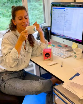 Celina in her natural habitat. Enjoying her first cup of Diego Samuel.